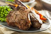 pic of lamb chops  - Homemade Cooked Lamb Chops with Peas and Carrots - JPG