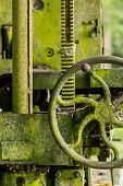 Moss Covered Farm Machinery With Handle