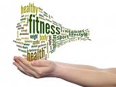Concept or conceptual abstract fitness and health word cloud with a hand on touch screen on white ba