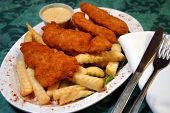 pic of fried chicken  - Fried Chicken Tenders served with French Fries on a bed of lettuce - JPG