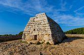 stock photo of megaliths  - Menorca Ciutadella Naveta des Tudons megalithic chamber tomb In Balearic islands - JPG