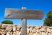 Wooden track blank road sign in Mediterranean Balearic islands