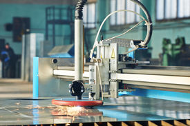 picture of sparking  - Industrial laser or plasma cutting processing manufacture technology of flat sheet metal steel material with sparks - JPG