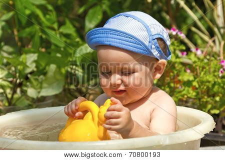 child is bathed in a basin