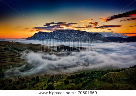 beautiful mountain landscape in foggy morning in Alba, Romania