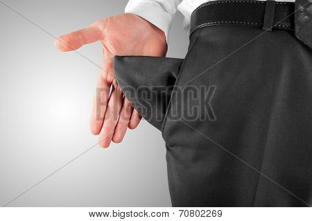 Business Man Showing Empty Pocket