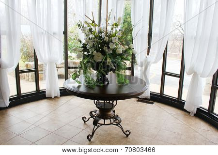 Pretty table and decorations in a wedding chapel
