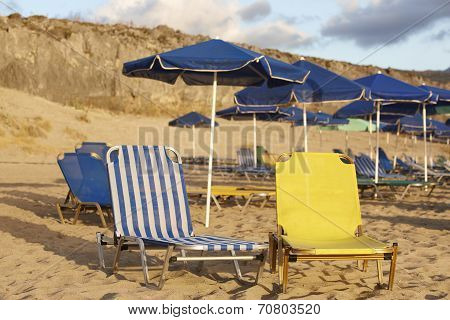 Sunbeds And Sunshades In A Mediterranean Beach. Crete