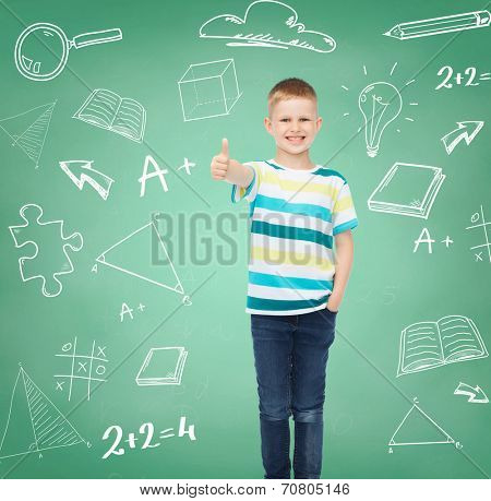 happiness, childhood, school, education and people concept - smiling little boy showing thumbs up over green board with doodles background
