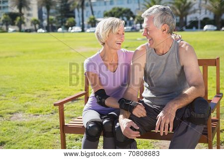 Active senior couple ready to go rollerblading on a sunny day