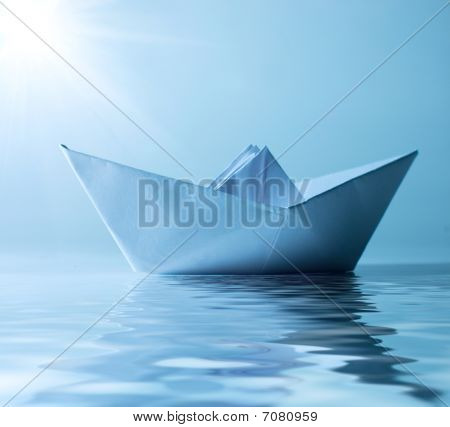 Concept Paper Ship In Water And Sunny Blue Sky