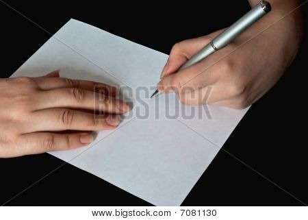 Woman Writing On A Blank Sheet Of Paper