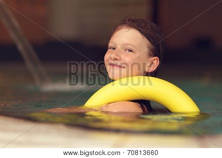 Proud Young Girl Swimming In A Pool