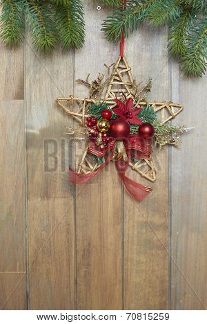Christmas star on wooden background