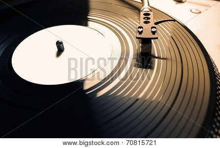 Old Fashioned Turntable Playing A Track poster