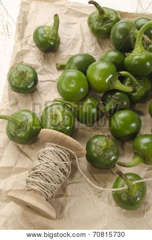 Green Cherry Peppers Prepare To Dry