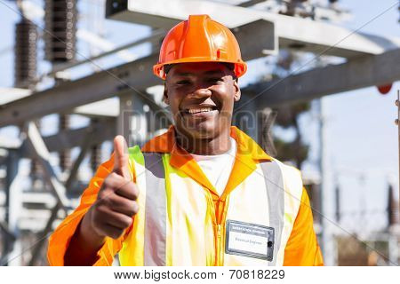 portrait of african electrician with thumb up at substation