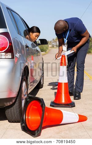 pretty female black learner driver made a mistake when reverse