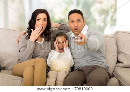 family watching scary movies at home
