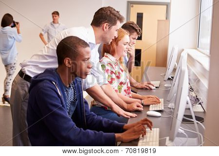 College Students Using Computers On Media Studies Course