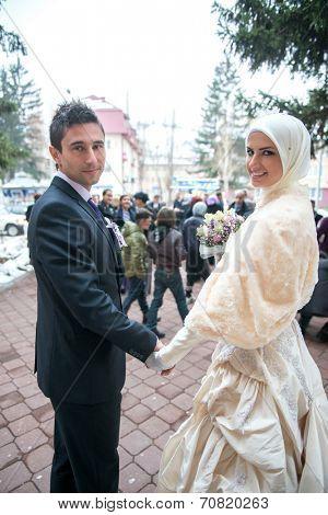 Posing just married muslim couple