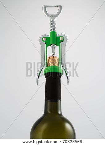 Green and chrome corkscrew wine opener with wine bottle
