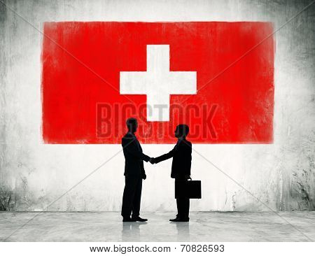 Switzerland flag and a group of business people.