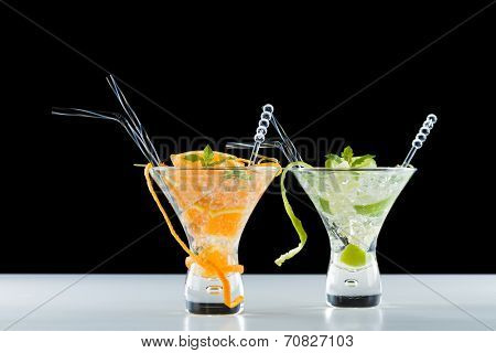 Fresh Orange and lime Mojito over black and white background