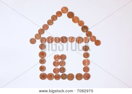 Shape Of House Made Out Of Coins
