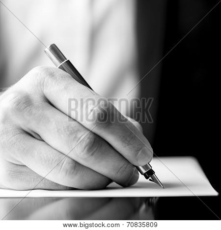 Male Hand Holding A Fountain Pen As Though Writing