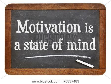 motivation is a state of mind - motivational phrase  on a vintage slate blackboard