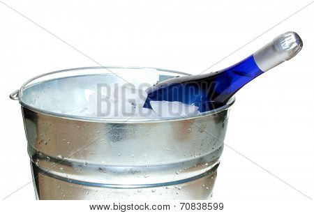 A Blue Champagne in a bucket of ice. Isolated on white with room for your text. Champagne and Sparkling Wine are enjoyed around the world by humans for celebrations, parties, birthdays, and weddings