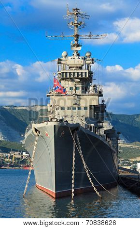 Battleship docked at a harbor