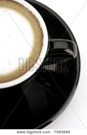 Espresso macchiato shot in half