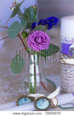 Decoration For Wedding Table In Purple Color . Flowers And Candles. The Vintage.