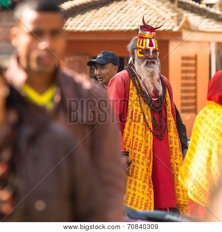 KATHMANDU, NEPAL - DEC 2, 2013: Unknown Sadhu Monk in Durbar Square. Kathmandu is largest city of Nepal, its economic center, a population of over 1 million people.
