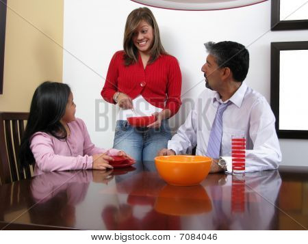 Family Smiling And Dining