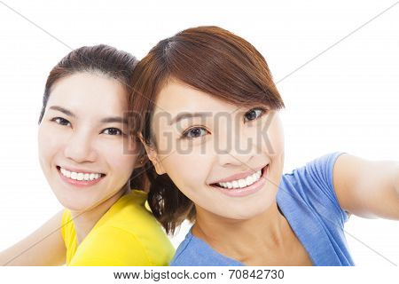 Closeup Of Two Happy Young Girls Over White Background