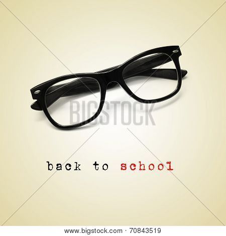 a pair of eyeglasses and the sentence back to school, with a retro effect