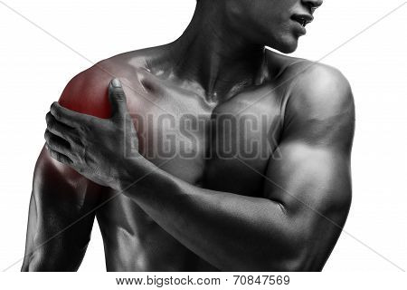 Young Muscular Man With Shoulder Pain , Isolated On White Background, Monochrome Photo