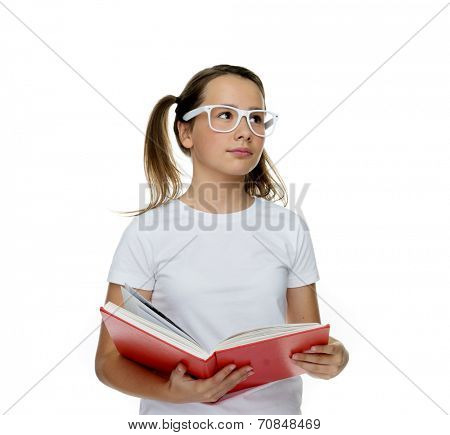 Young girl in trendy white glasses standing thinking with a book in her hands about something she has just read, isolated on white