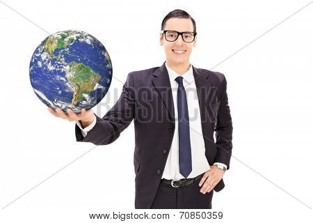 Happy young businessman holding a globe isolated on white background, Elements of this image furnished by NASA
