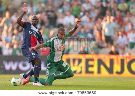 VIENNA, AUSTRIA - JULY 12 Terrence Boyd (#9 Rapid) and Zoumana Camara (#6 Paris) fight for the ball at a friendly soccer game on July 12, 2013 in Vienna, Austria.
