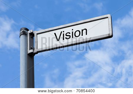 Signpost With Vision Sign Against Sky