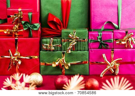 Three Stacks Of Xmas Presents Arranged By Color