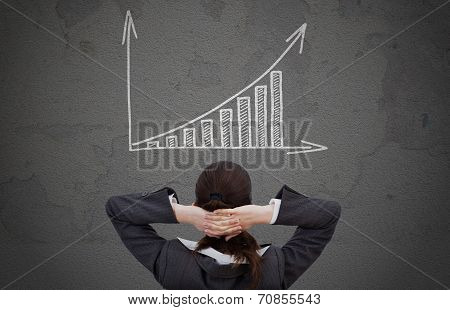 Businesswoman Looking At Increasing Graph