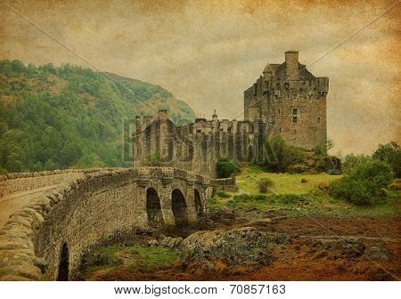 Eilean Donan castle in overcast spring day. low tide. Scotland, UK. Photo in retro style. Paper texture.