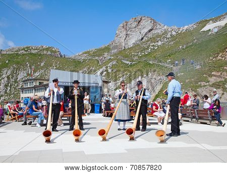 MOUNT PILATUS - JULY 13: Unidentified people preparing traditional alphorns for performance on July 13, 2013 on the top of Pilatus, Switzerland. Alphorn is traditional music instrument of Switzerland.
