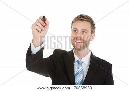 Businessman Writing On Invisible Screen With Marker