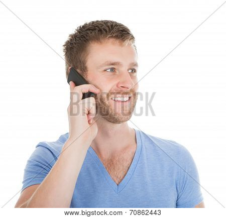 Happy Man Answering Cell Phone While Looking Away
